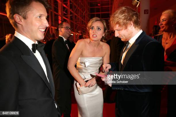 Singer James Blunt Caren Miosga looks for a pen for an autograph of singer Ed Sheeran during the Goldene Kamera reception at Messe Hamburg on March 4...