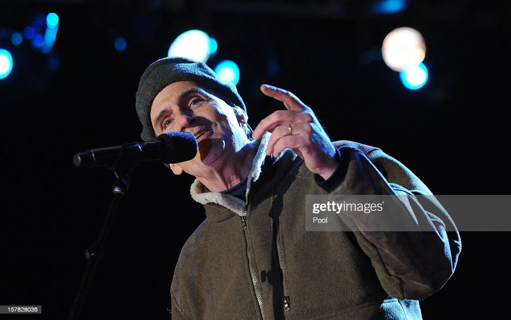 Singer James Taylor performs at a concert during the 90th National Christmas Tree Lighting Ceremony on the Ellipse behind the White House on December 6, 2012 in Washington, DC. This year is the 90th annual National Christmas Tree Lighting Ceremony.