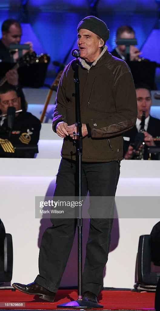 Singer James Taylor sings during the annual lighting of the National Christmas tree on December 6, 2012 in Washington, DC. President Obama and his family participated in this year's 90th annual National Christmas Tree Lighting Ceremony.