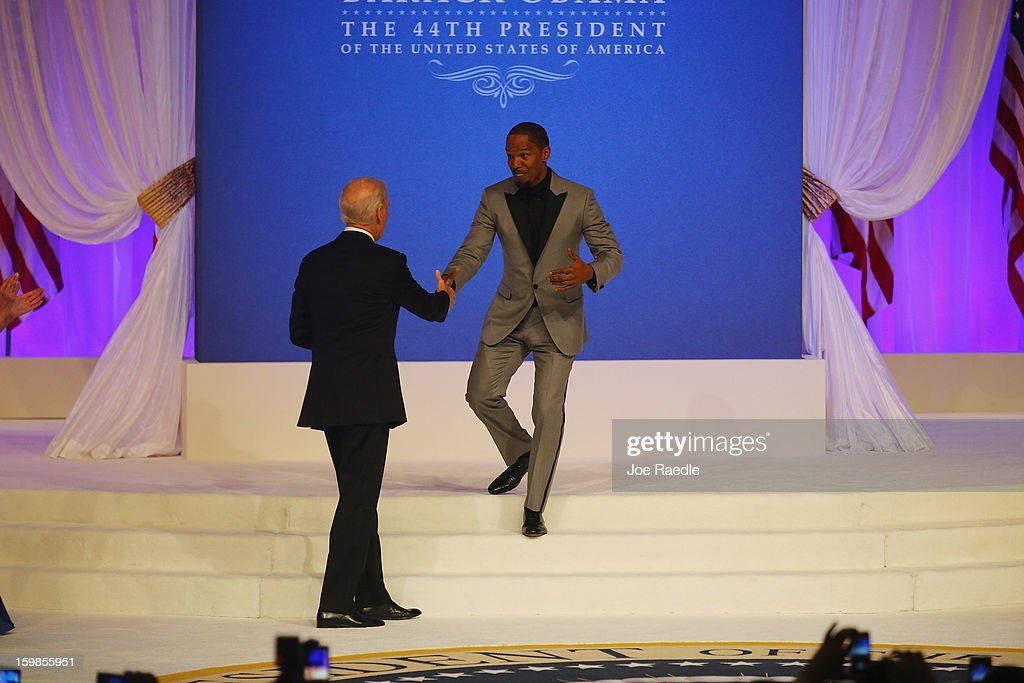 Singer Jamie Foxx shakes hands with Vice-President Joe Biden during the Commander-In-Chief's Inaugural Ball January 21, 2013 in Washington, DC. President Barack Obama is scheduled to show up at the ball after being sworn in today for his second term in a public ceremonial swearing in.