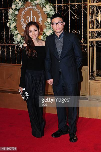 Singer Jane Zhang and her boyfriend Feng Ke walk the red carpet during Huang Xiaoming and Anglababy's wedding ceremony at Shanghai Exhibition Center...