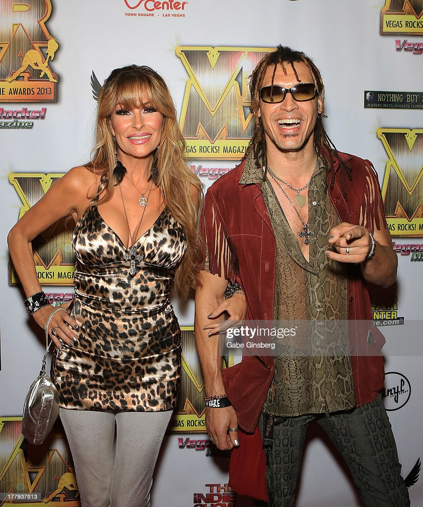 Singer Janea Ebsworth (L) and her husband, guitarist/singer Jason Ebs of the group Ecotonic arrive at the 2013 Vegas Rocks! magazine music awards at The Joint inside the Hard Rock Hotel & Casino on August 25, 2013 in Las Vegas, Nevada.
