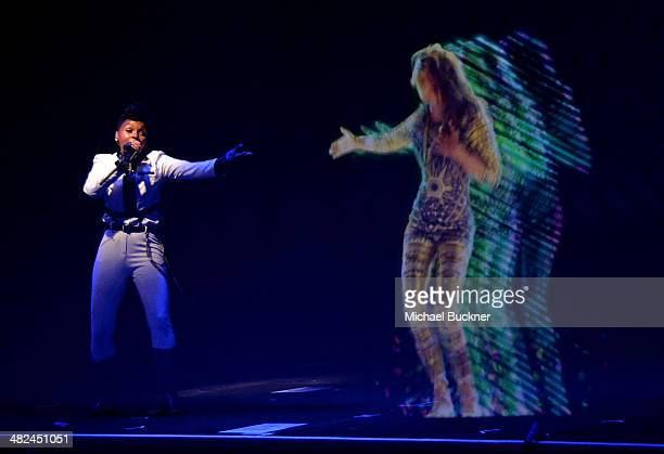 Singer Janelle Monae and a MIA hologram perform during the Audi A3 Launch Event with Janelle Monae at Quixote Studios on April 3 2014 in Los Angeles...