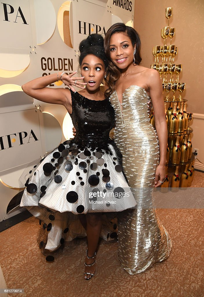 Singer Janelle Monae (L) and Naomie Harris attend the 74th Annual Golden Globe Awards at The Beverly Hilton Hotel on January 8, 2017 in Beverly Hills, California.