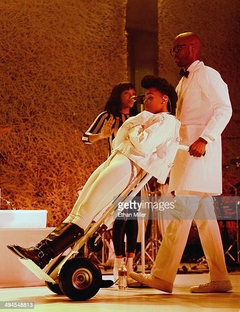 Singer Janelle Monae is wheeled onto the stage at the Couture Las Vegas jewelry show at Wynn Las Vegas on May 29 2014 in Las Vegas Nevada