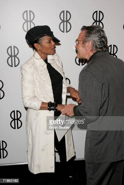 Singer Janet Jackson and designer Michael Volbracht talk backstage at the Bill Blass Spring 2007 fashion show during Olympus Fashion Week at the Tent...