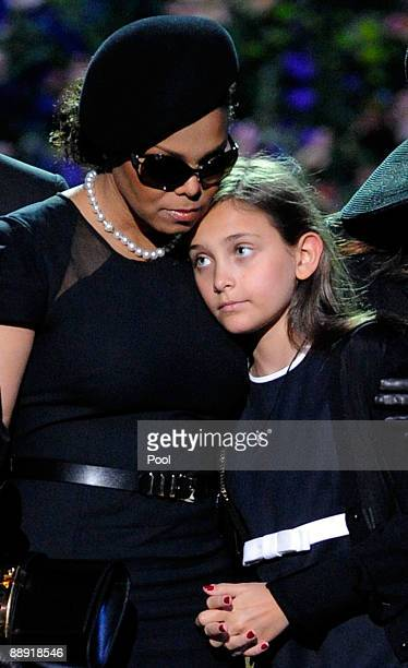 Singer Janet Jackson and Michael Jackson's daughter Paris Katherine Jackson hug onstage during the Michael Jackson public memorial service held at...