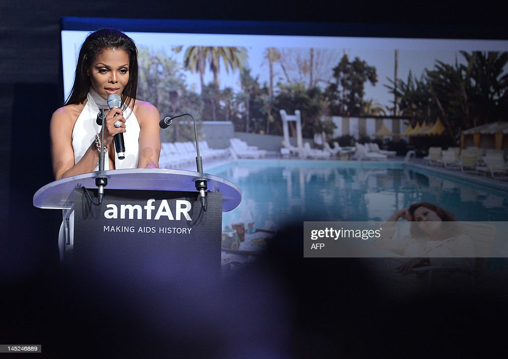 US singer Janet Jackson leads an auction at the 2012 amfAR's Cinema Against Aids benefit gala on May 24, 2012 in Antibes, southeastern France. AFP PHOTO / ALBERTO PIZZOLI