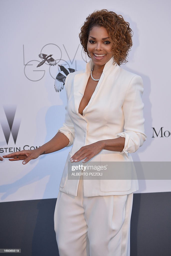 US singer Janet Jackson poses on May 23, 2013 as she arrives for the amfAR's 20th Annual Cinema Against AIDS during the 66th Annual Cannes Film Festival at Hotel du Cap-Eden-Roc in Cap d'Antibes, southern France.