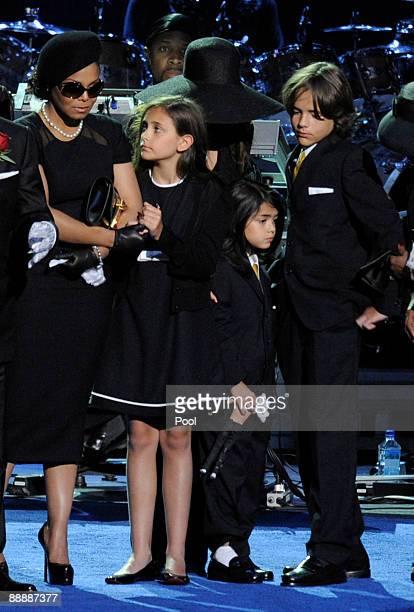 Singer Janet Jackson stands on stage with Michael Jackson's children Paris Jackson Prince Michael Jackson II and Prince Michael Jackson at the...