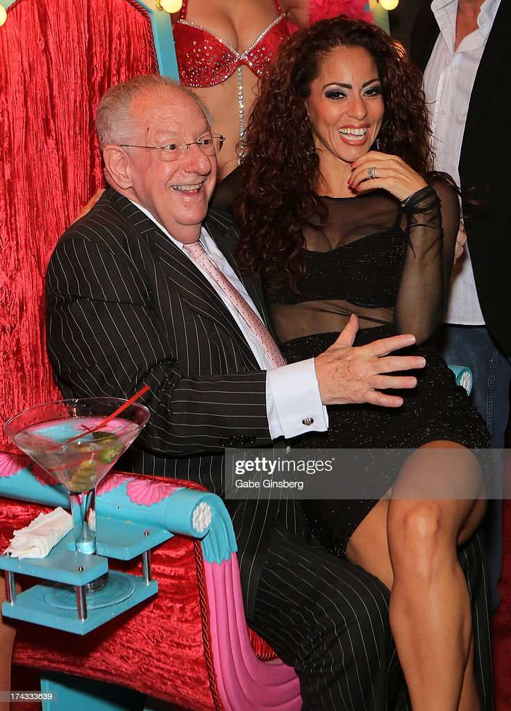 Singer Janien Valentine (R) sits on Chairman of the Las Vegas Host Committee <a gi-track='captionPersonalityLinkClicked' href=/galleries/search?phrase=Oscar+Goodman&family=editorial&specificpeople=646020 ng-click='$event.stopPropagation()'>Oscar Goodman</a>'s lap at the 'Showbiz Roast of <a gi-track='captionPersonalityLinkClicked' href=/galleries/search?phrase=Oscar+Goodman&family=editorial&specificpeople=646020 ng-click='$event.stopPropagation()'>Oscar Goodman</a>' at the Stratosphere Casino Hotel on July 23, 2013 in Las Vegas, Nevada.