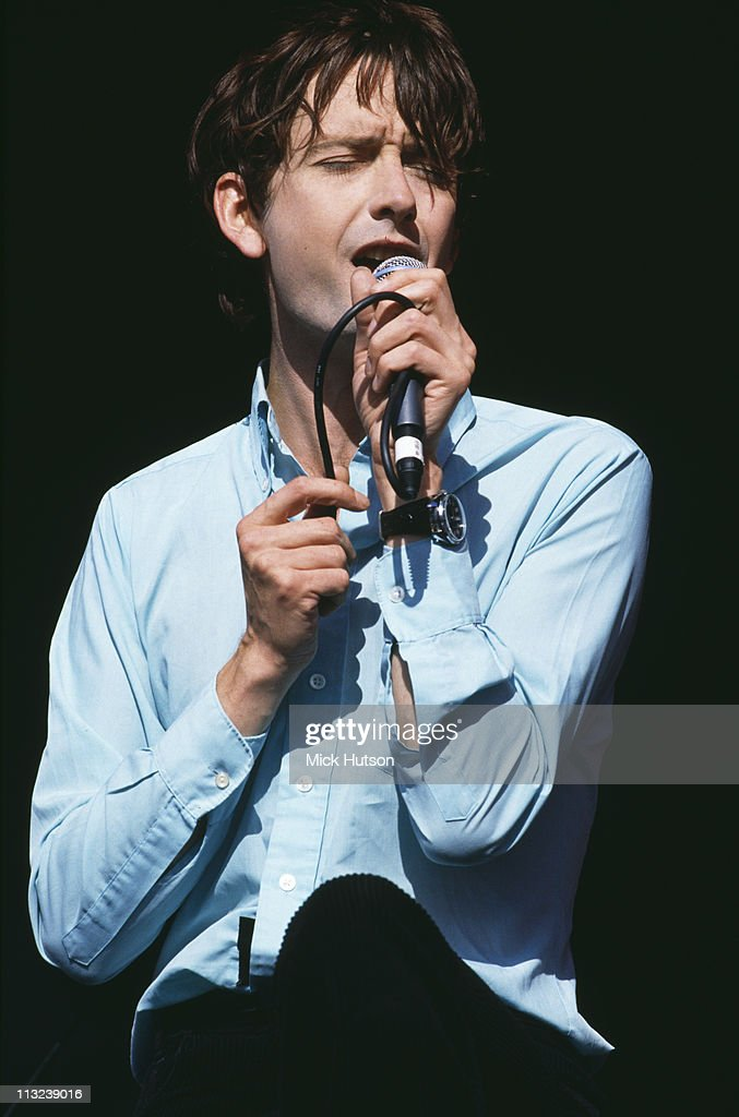 Singer Jarvis Cocker performing on stage with English pop group Pulp at the Reading Festival, 27th August 1994.