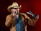 Singer Jason Aldean accepts the award for Male Vocalist of the Year onstage during the 50th Academy of Country Music Awards at ATT Stadium on April...