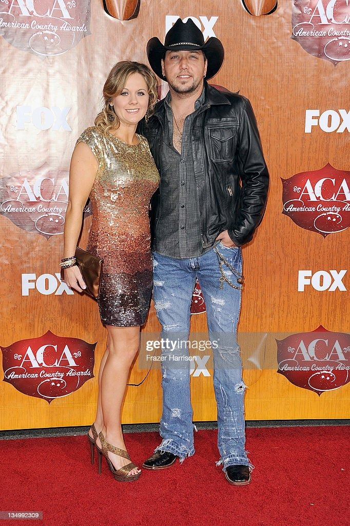 Singer <a gi-track='captionPersonalityLinkClicked' href=/galleries/search?phrase=Jason+Aldean&family=editorial&specificpeople=619221 ng-click='$event.stopPropagation()'>Jason Aldean</a> (R) and Jessica Aldean arrive at the American Country Awards 2011 at the MGM Grand Garden Arena on December 5, 2011 in Las Vegas, Nevada.
