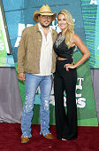Singer Jason Aldean and wife Brittany Kerr attend the 2015 CMT Music awards at the Bridgestone Arena on June 10 2015 in Nashville Tennessee