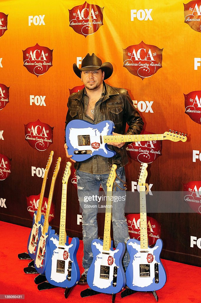 Singer Jason Aldean poses in the press room with the awards for Artist of the Year Album of the Year Singer of the Year Male Single of the Year Vocal...