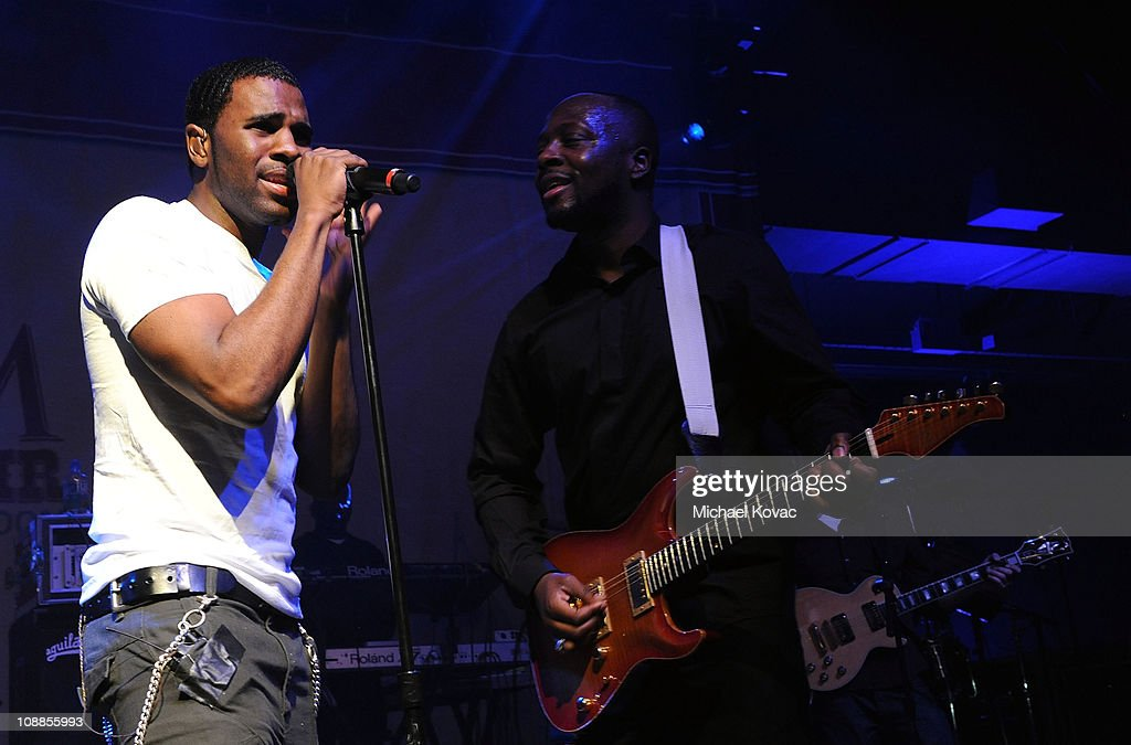 Singer Jason Derulo and musician Wyclef Jean preform with AOL at the Maxim Party Powered by Motorola Xoom at Centennial Hall at Fair Park on February 5, 2011 in Dallas, Texas.
