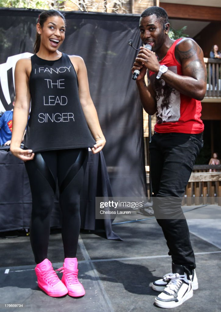 Singer <a gi-track='captionPersonalityLinkClicked' href=/galleries/search?phrase=Jason+Derulo&family=editorial&specificpeople=5745869 ng-click='$event.stopPropagation()'>Jason Derulo</a> (R) brings girlfriend, singer <a gi-track='captionPersonalityLinkClicked' href=/galleries/search?phrase=Jordin+Sparks&family=editorial&specificpeople=4165535 ng-click='$event.stopPropagation()'>Jordin Sparks</a> on stage during his summer sessions performance at Warner Bros. Records Boutique Store on August 16, 2013 in Burbank, California.