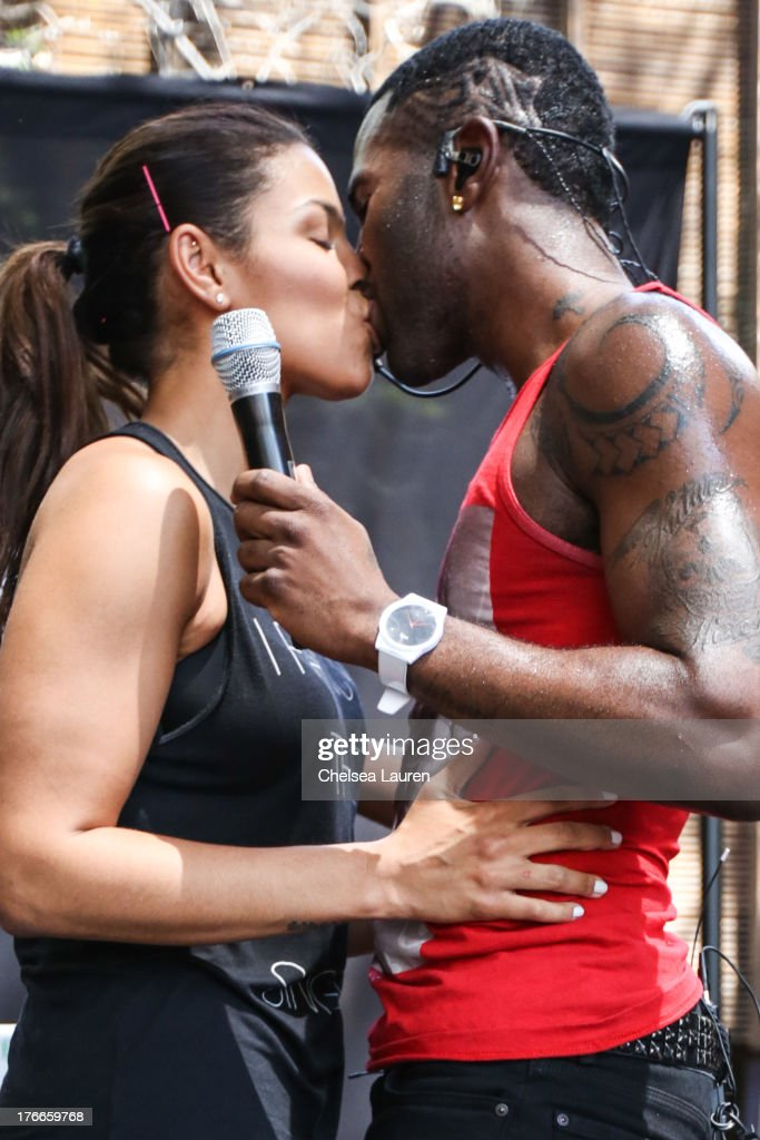Singer Jason Derulo (R) brings girlfriend, singer Jordin Sparks on stage during his summer sessions performance at Warner Bros. Records Boutique Store on August 16, 2013 in Burbank, California.