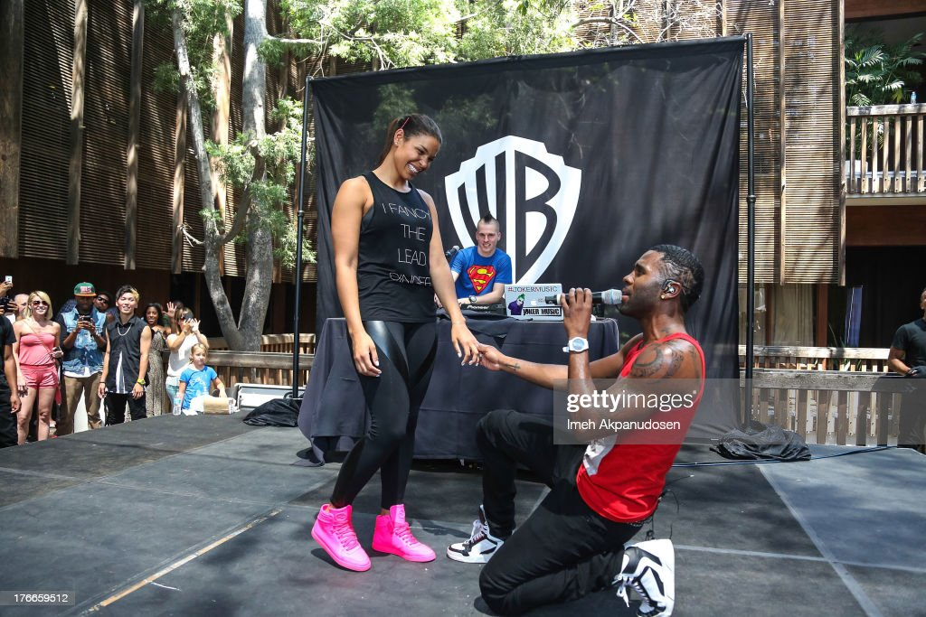 Singer Jason Derulo (R) brings singer Jordin Sparks onstage during his performance at the WBR Summer Sessions at Warner Bros. Records Boutique Store on August 16, 2013 in Burbank, California.