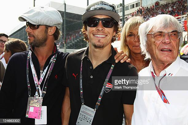 Singer Jay Kay Moto GP rider Nicky Hayden of Ducati and F1 supremo Bernie Ecclestone are seen on the grid before the Italian Formula One Grand Prix...