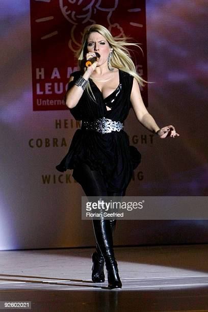 Singer Jeanette Biedermann performs at the 'Event Prominent 2009' fashion show at the Hotel Grand Elysee on November 1 2009 in Hamburg Germany