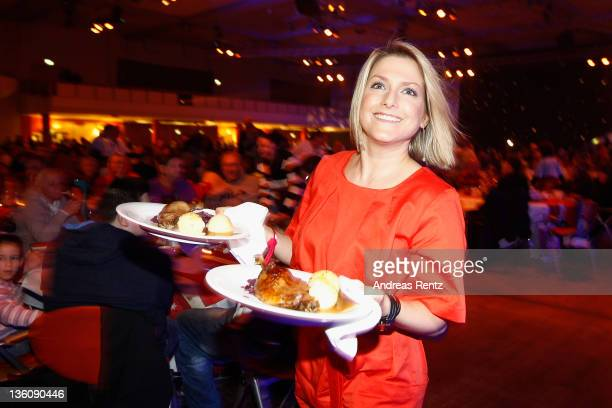 Singer Jeanette Biedermann serves Christmas goose dinner to homeless and poor people at the 17th annual Christmas Celebration for the Homeless at...