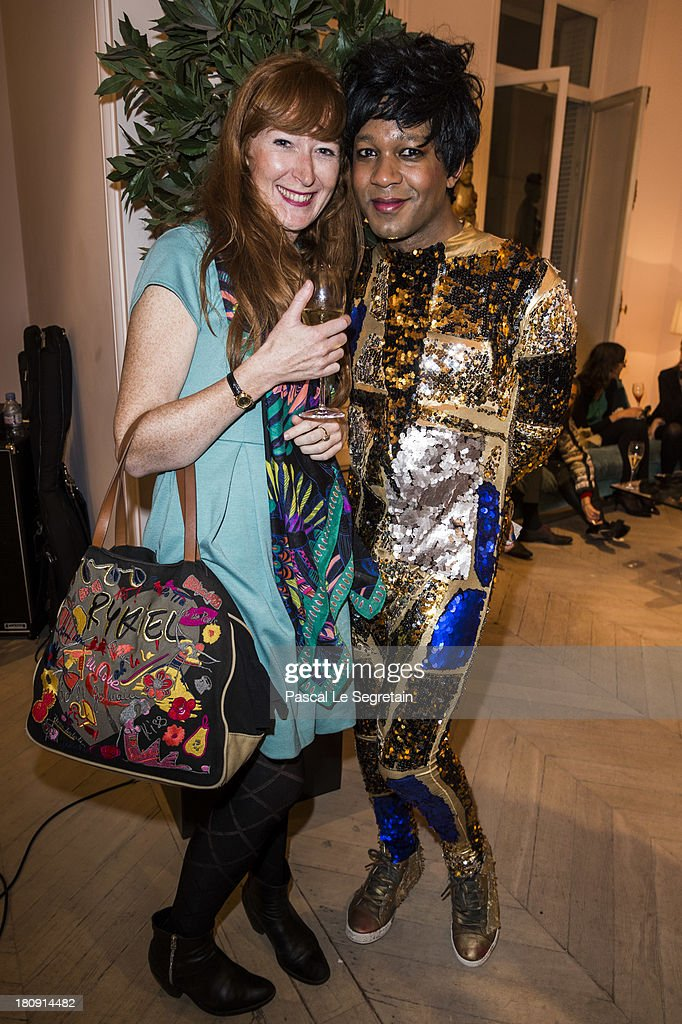 Singer Jef Barbara (R) and guest attend the Vogue Fashion Night Out event at boutique Roger Vivier on 29 Faubourg Saint-Honore, on September 17, 2013 in Paris, France.