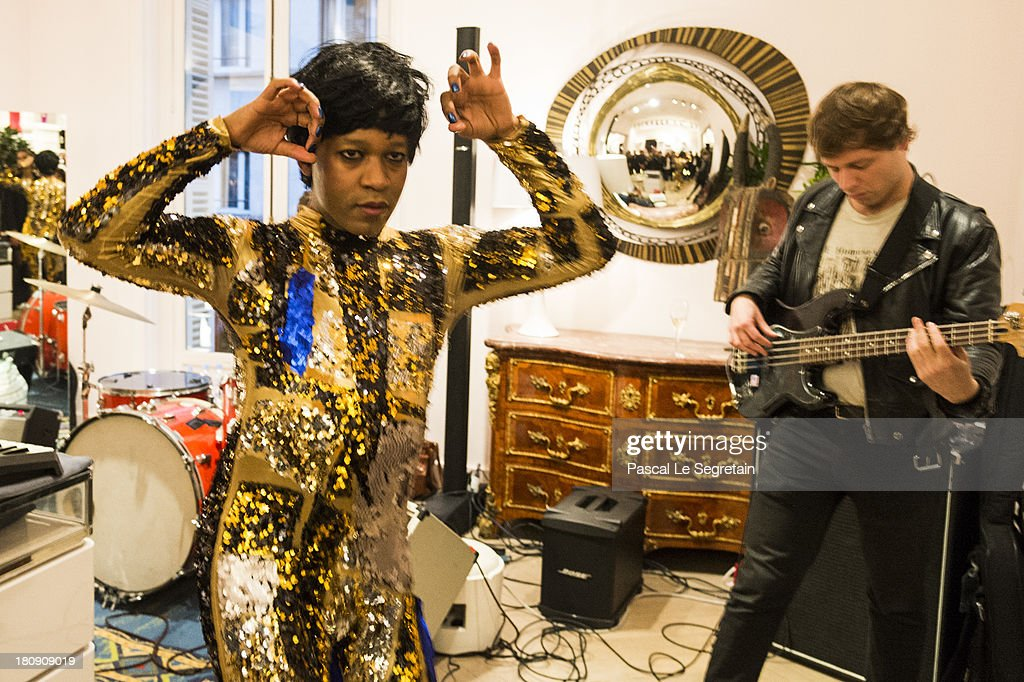Singer Jef Barbara (L) performs during the Vogue Fashion Night Out event at boutique Roger Vivier on 29 Faubourg Saint-Honore, on September 17, 2013 in Paris, France.