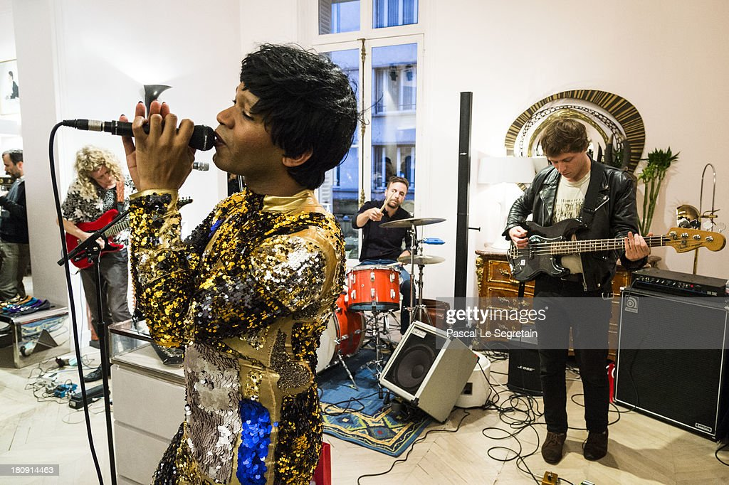 Singer Jef Barbara (C) performs during the Vogue Fashion Night Out event at boutique Roger Vivier on 29 Faubourg Saint-Honore, on September 17, 2013 in Paris, France.