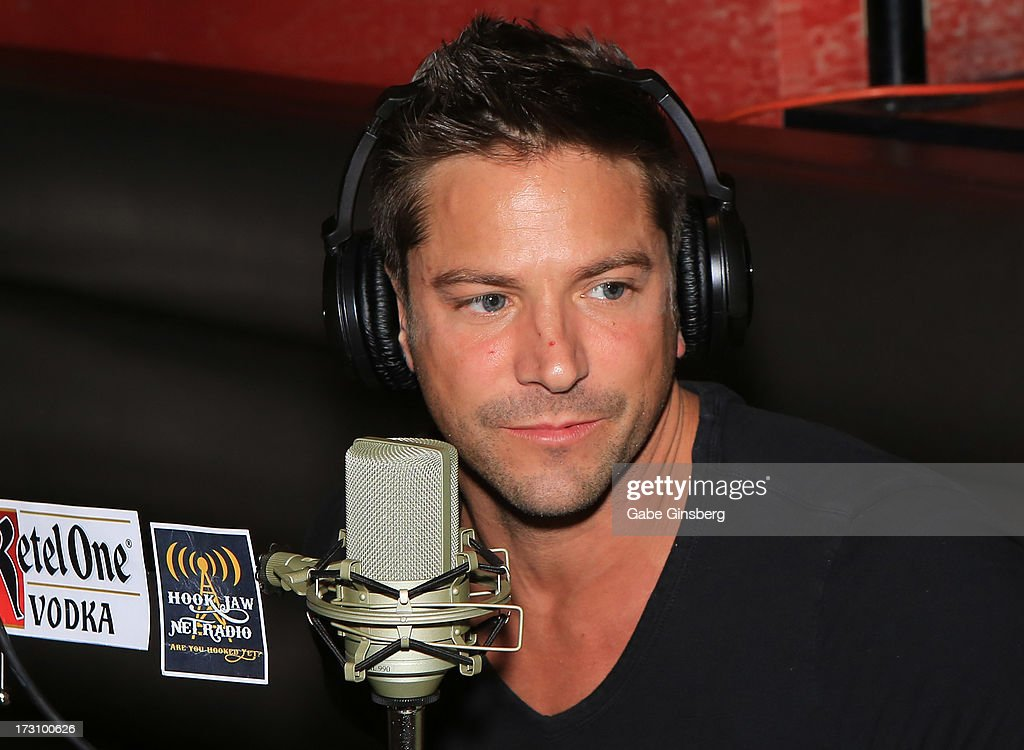 Singer <a gi-track='captionPersonalityLinkClicked' href=/galleries/search?phrase=Jeff+Timmons&family=editorial&specificpeople=994981 ng-click='$event.stopPropagation()'>Jeff Timmons</a> of 98 Degrees is interviewed on the 'On Air With Robert & CC' podcast at the PBR Rock Bar & Grill inside the Miracle Mile Shops at Planet Hollywood Resort & Casino on July 6, 2013 in Las Vegas, Nevada.