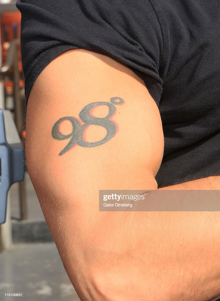 Singer <a gi-track='captionPersonalityLinkClicked' href=/galleries/search?phrase=Jeff+Timmons&family=editorial&specificpeople=994981 ng-click='$event.stopPropagation()'>Jeff Timmons</a> (tattoo detail) of 98 Degrees is interviewed on the 'On Air With Robert & CC' podcast at the PBR Rock Bar & Grill inside the Miracle Mile Shops at Planet Hollywood Resort & Casino on July 6, 2013 in Las Vegas, Nevada.