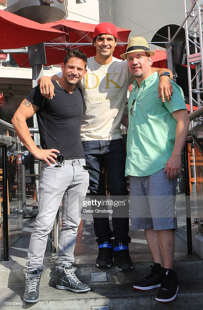 Singer <a gi-track='captionPersonalityLinkClicked' href=/galleries/search?phrase=Jeff+Timmons&family=editorial&specificpeople=994981 ng-click='$event.stopPropagation()'>Jeff Timmons</a> of 98 Degrees, professional BMX dirt jumper <a gi-track='captionPersonalityLinkClicked' href=/galleries/search?phrase=Ricardo+Laguna&family=editorial&specificpeople=5918597 ng-click='$event.stopPropagation()'>Ricardo Laguna</a> and singer <a gi-track='captionPersonalityLinkClicked' href=/galleries/search?phrase=Justin+Jeffre&family=editorial&specificpeople=994982 ng-click='$event.stopPropagation()'>Justin Jeffre</a> of 98 Degrees is interviewed on the 'On Air With Robert & CC' podcast at the PBR Rock Bar & Grill inside the Miracle Mile Shops at Planet Hollywood Resort & Casino on July 6, 2013 in Las Vegas, Nevada.