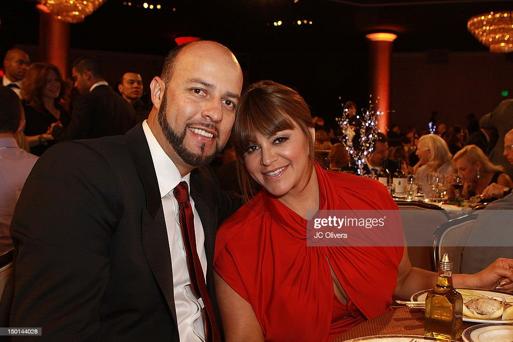 Singer <a gi-track='captionPersonalityLinkClicked' href=/galleries/search?phrase=Jenni+Rivera&family=editorial&specificpeople=666166 ng-click='$event.stopPropagation()'>Jenni Rivera</a> and her husband <a gi-track='captionPersonalityLinkClicked' href=/galleries/search?phrase=Esteban+Loaiza&family=editorial&specificpeople=220221 ng-click='$event.stopPropagation()'>Esteban Loaiza</a> attend the 27th Annual Imagen Awards at The Beverly Hilton Hotel on August 10, 2012 in Beverly Hills, California.