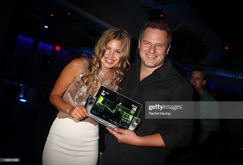 Singer Jennifer Akerman (L) and Wikipad CEO James Bower attend the VIP red carpet cocktail party hosted by WIKIPAD and NVIDIA as part of the celebrations for E3,2012 held at Elevate Lounge on June 6, 2012 in Los Angeles, California.