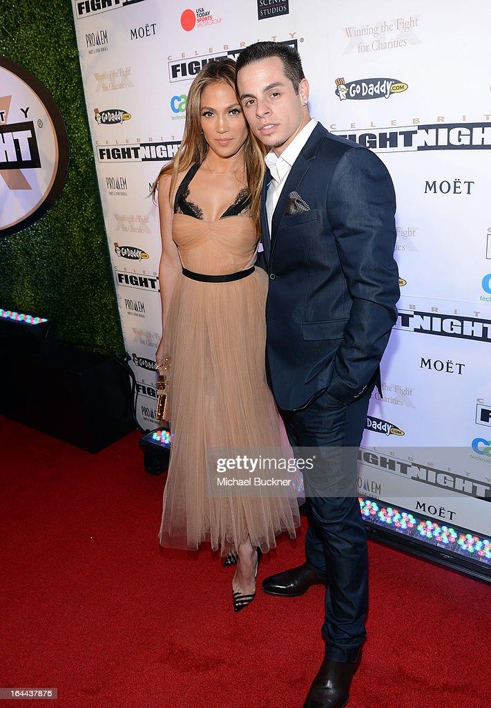 Singer Jennifer Lopez and dancer Casper Smart attend Muhammad Ali's Celebrity Fight Night XIX at JW Marriott Desert Ridge Resort & Spa on March 23, 2013 in Phoenix, Arizona.