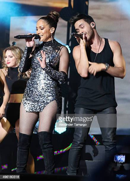 Singer Jennifer Lopez and Prince Royce perform onstage at iHeartRadio Fiesta Latina presented by Sprint at American Airlines Arena on November 7 2015...