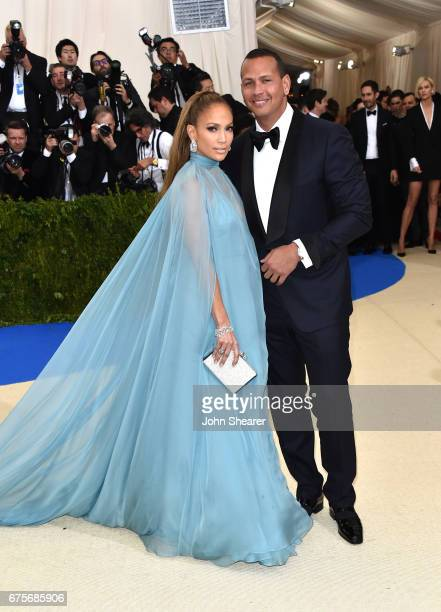 Singer Jennifer Lopez and professional baseball player Alex Rodriguez attend 'Rei Kawakubo/Comme des Garcons Art Of The InBetween' Costume Institute...