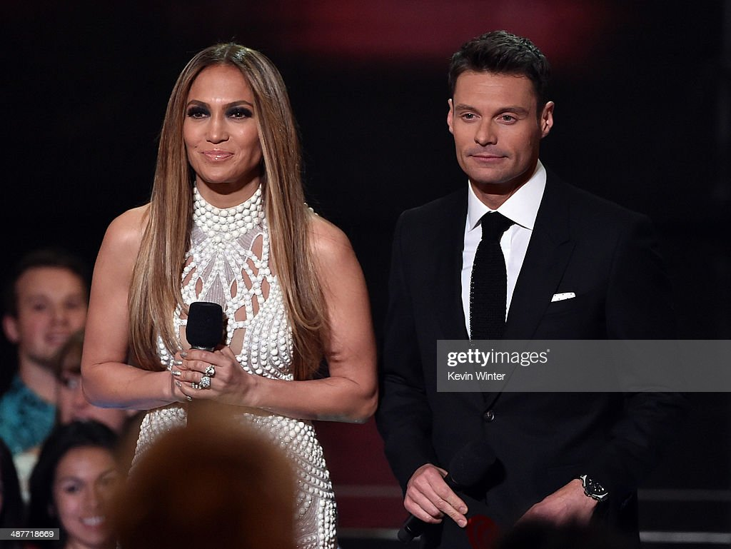 Singer Jennifer Lopez (L) and TV personality Ryan Seacrest speak onstage during the 2014 iHeartRadio Music Awards held at The Shrine Auditorium on May 1, 2014 in Los Angeles, California. iHeartRadio Music Awards are being broadcast live on NBC.