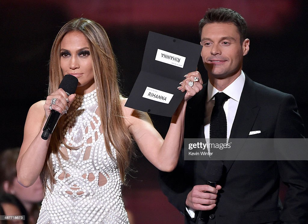 Singer Jennifer Lopez and TV personality Ryan Seacrest speak onstage during the 2014 iHeartRadio Music Awards held at The Shrine Auditorium on May 1...