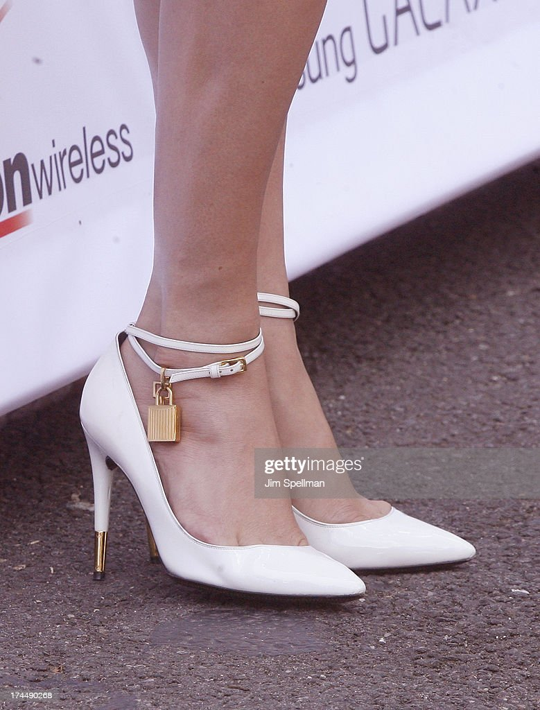 Singer Jennifer Lopez (shoe detail) attends the flagship store celebration at Viva Movil on July 26, 2013 in New York City.