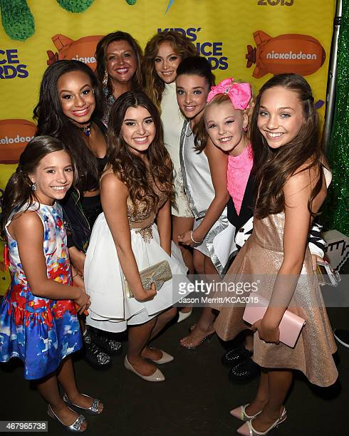 Singer Jennifer Lopez poses with tv personality Abby Lee Miller and dancers Mackenzie Ziegler Nia Sioux Frazier Kalani Hilliker Kendall Vertes Chloe...