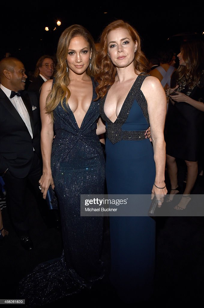Singer Jennifer Lopez wearing Gucci and actress Amy Adams wearing Gucci attend the 2014 LACMA Art Film Gala honoring Barbara Kruger and Quentin...