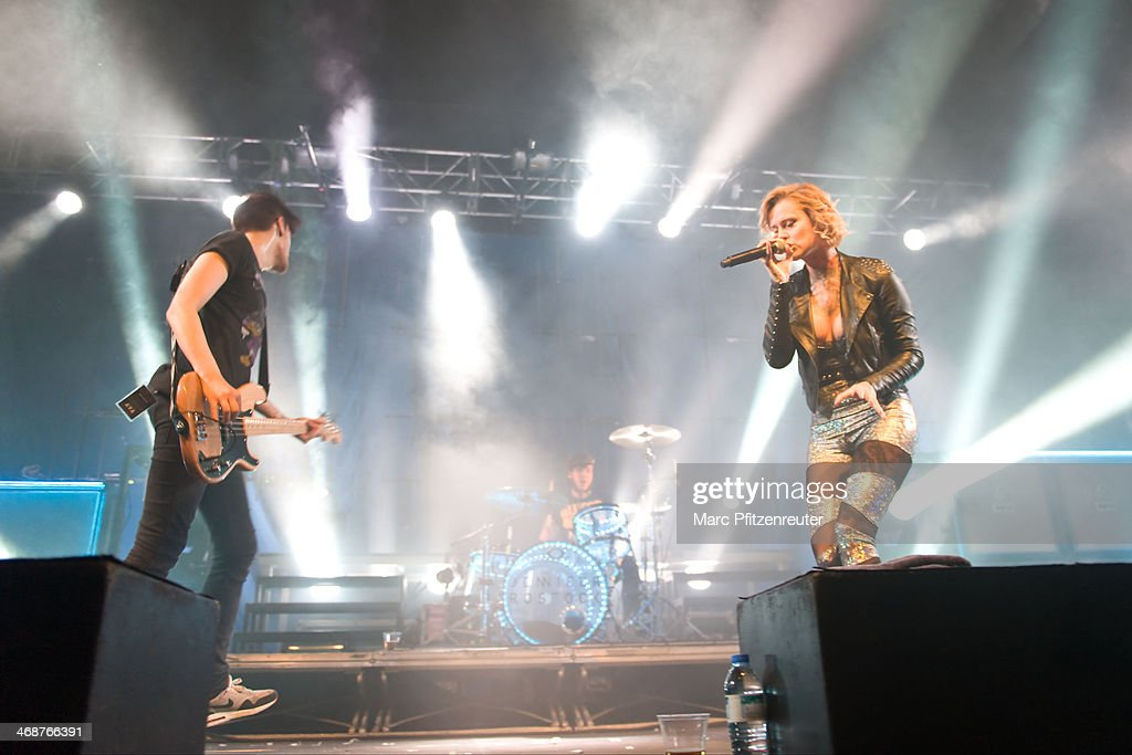 Singer Jennifer Weist of the German rock band Jennifer Rostock, bassist Christoph Deckert and drummer Christopher 'Baku' Kohl perform during their 'Schlaflos Tour', at the Palladium on February 11, 2014 in Cologne, Germany.