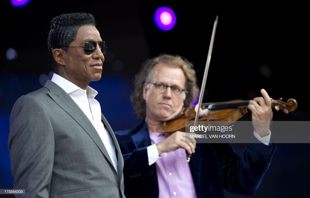 US singer Jermaine Jackson (L) and Dutch violinist Andre Rieu perform during the sound check in Vrijthof square in Maastricht, on July 12, 2013. Jackson will perform with Rieu and his orchestra later in the day. netherlands out