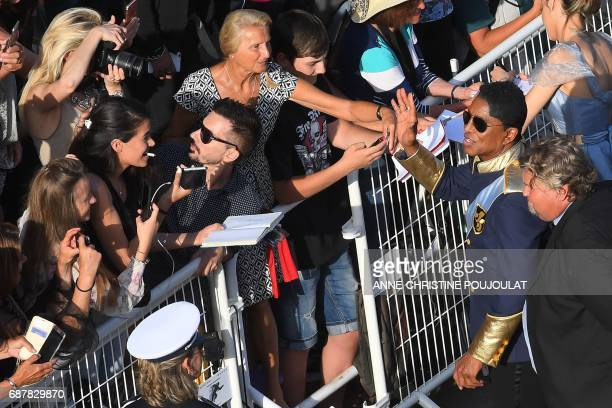 US singer Jermaine Jackson greets fans as he arrives on May 24 2017 for the screening of the film 'The Beguiled' at the 70th edition of the Cannes...