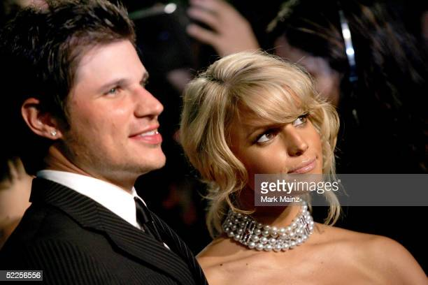 Singer Jessica Simpson and her husband Nick Lachey arrive at the Vanity Fair Oscar Party at Mortons on February 27 2005 in West Hollywood California