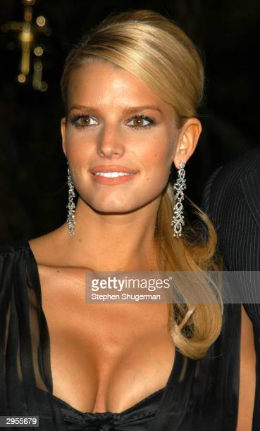 Singer Jessica Simpson arrives at The Clive Davis PreGrammy Party at The Beverly Hills Hotel on February 7 2004 in Beverly Hills California