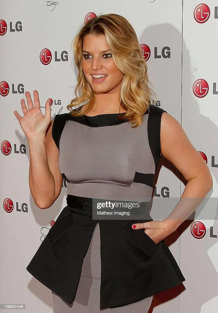 Singer Jessica Simpson arrives at the Victoria Beckham and Eva Longoria Parker Host a Night of Fashion and Technology with LG Mobile Phones at Soho House on May 24, 2010 in West Hollywood, California.