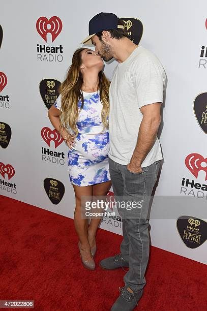 Singer Jessie James Decker and NFL player Eric Decker attend the 2015 iHeartRadio Country Festival at The Frank Erwin Center on May 2 2015 in Austin...